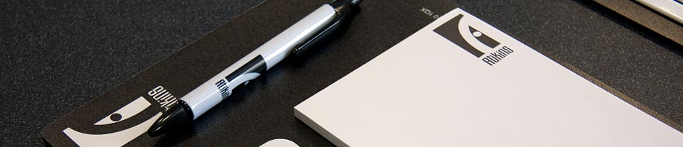a photo of a 'The Atkins' branded notepad and pen