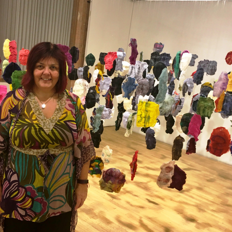 A photo of 'Artist Penny Andrews with her work' by Penny Andrews