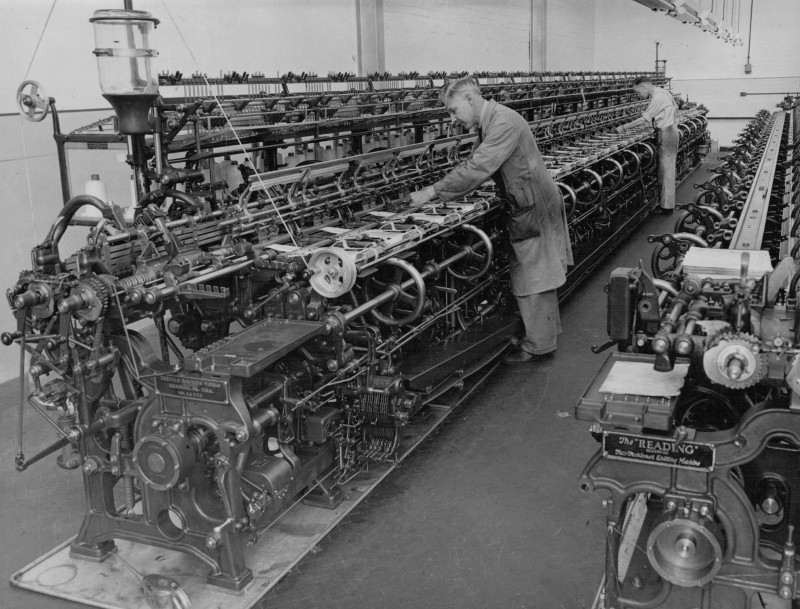 A photo of 'Reading Machines, a type of knitting machine in use at Atkins factory' by Hinckley & District Museum