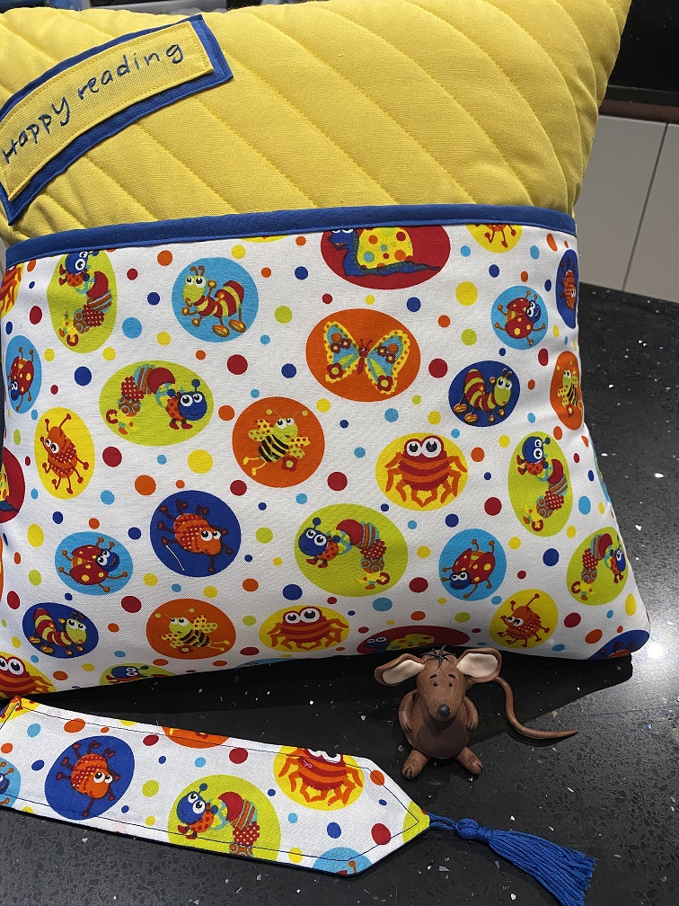 A photo of 'Yellow Bugs Cushion' by Fat Brown Mouse Designs